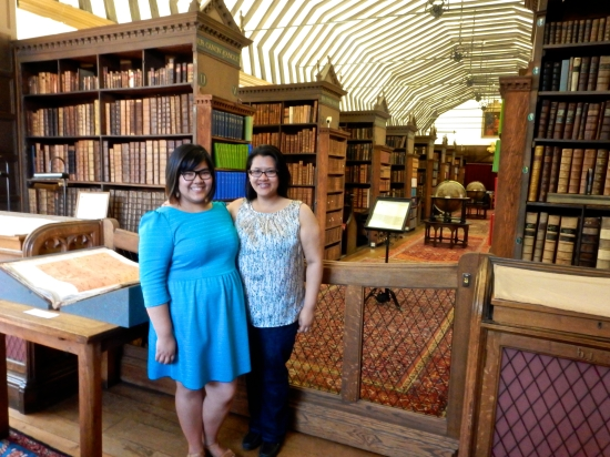 Myself and the sestra, surrounded by immense amounts of history in St. John's College Library. (Nikon S9700)
