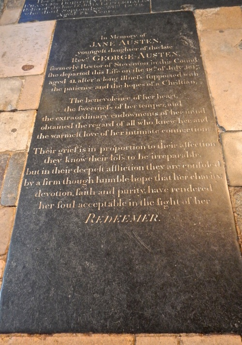 At my feet lay buried Jane Austen, one of England's best known writers. Though she had many ties to other places like Bath, it was here in Winchester where she finally passed away and was laid to rest. On her gravestone, the sweetest message is written, and yet there is no mention whatsoever of her occupation and success as a writer. (Nikon S9700)